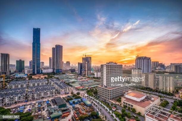 aerial view of cityscape against sky during sunset - hanoi stock pictures, royalty-free photos & images