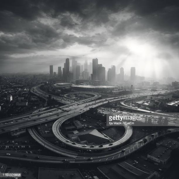 aerial view of cityscape against sky - de stad los angeles stockfoto's en -beelden