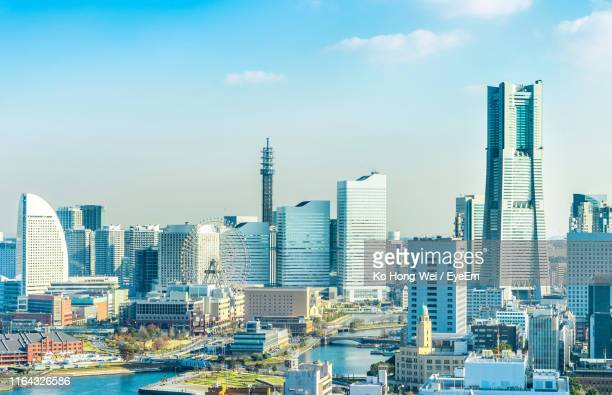 aerial view of cityscape against sky - yokohama stock pictures, royalty-free photos & images