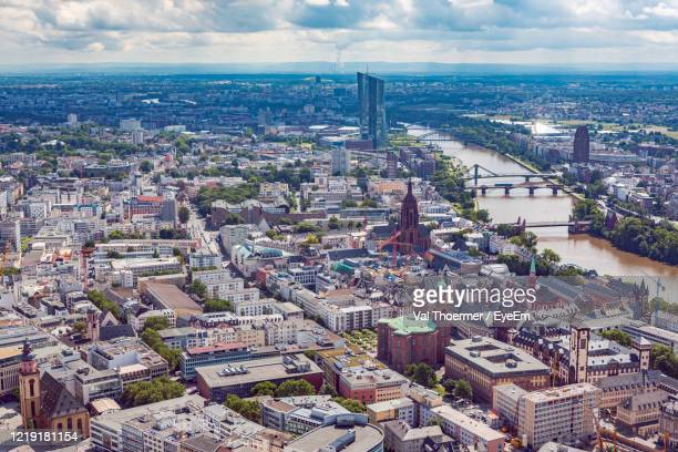 aerial view of cityscape against sky - val thoermer stock-fotos und bilder