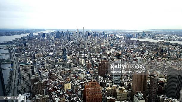 aerial view of cityscape against sky - adamo photos et images de collection