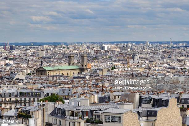 aerial view of cityscape against sky - marek stefunko stock photos and pictures