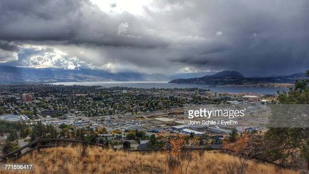 aerial view of cityscape against sky - kelowna stock pictures, royalty-free photos & images