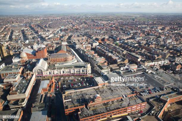 aerial view of cityscape against sky - blackpool stock photos and pictures