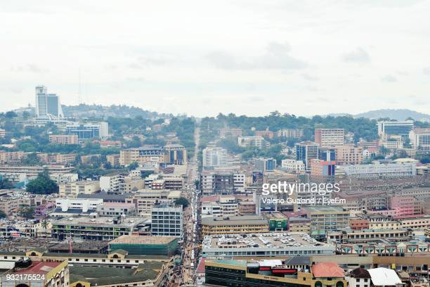 aerial view of cityscape against sky - kampala stock-fotos und bilder
