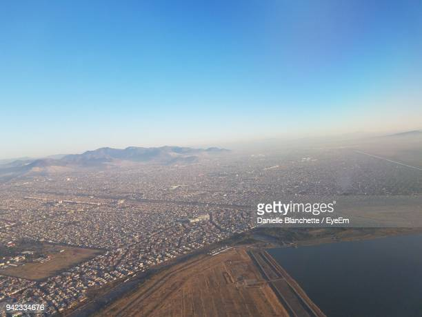 aerial view of cityscape against sky - mexico city aerial stock pictures, royalty-free photos & images