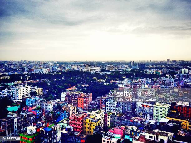 aerial view of cityscape against sky - bangladesh nature stock photos and pictures
