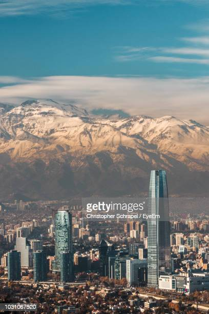 aerial view of cityscape against snowcapped mountains - santiago chile fotografías e imágenes de stock