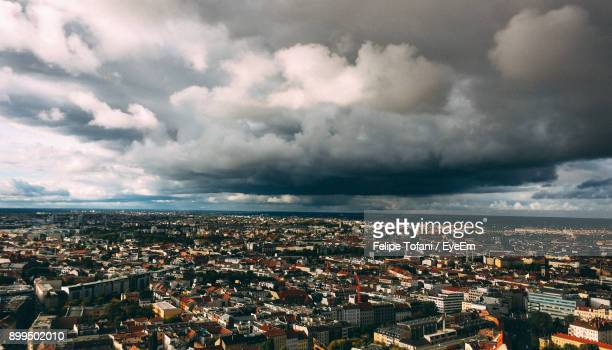 Aerial View Of Cityscape Against Storm Clouds