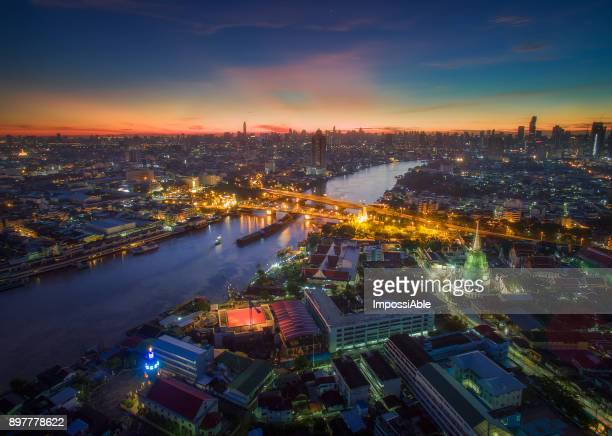 aerial view of cityscape and the chaophraya river in the morning sunrise, bangkok, thailand - impossiable stock pictures, royalty-free photos & images