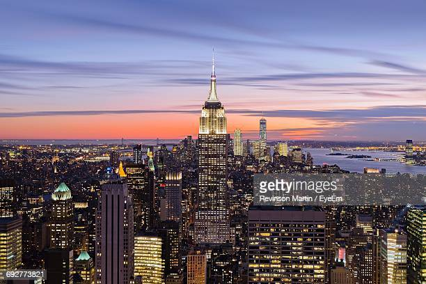 aerial view of cityscape at night - empire state building stock pictures, royalty-free photos & images