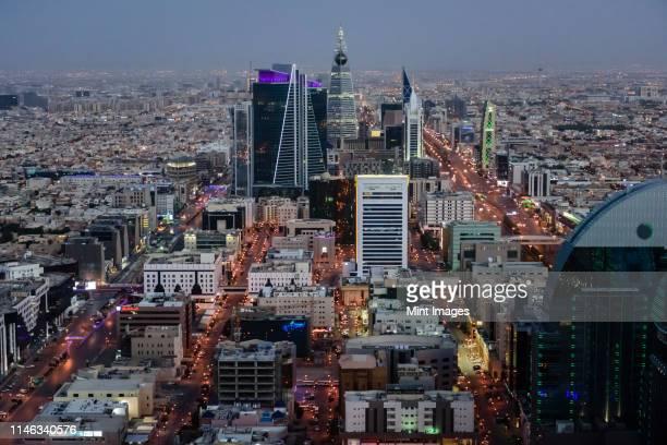 aerial view of cityscape at night, riyadh, saudi arabia - riyadh stock pictures, royalty-free photos & images