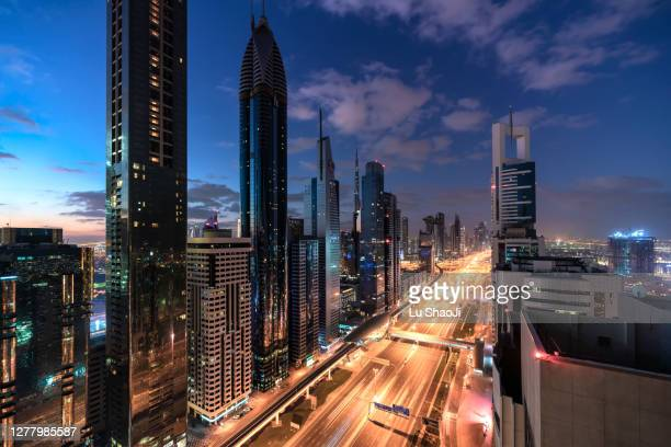 aerial view of cityscape at sunrise in dubai.uae - dubai stock pictures, royalty-free photos & images