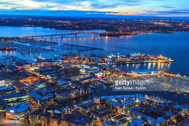 Aerial View Of Cityscape By Harbor At Dusk