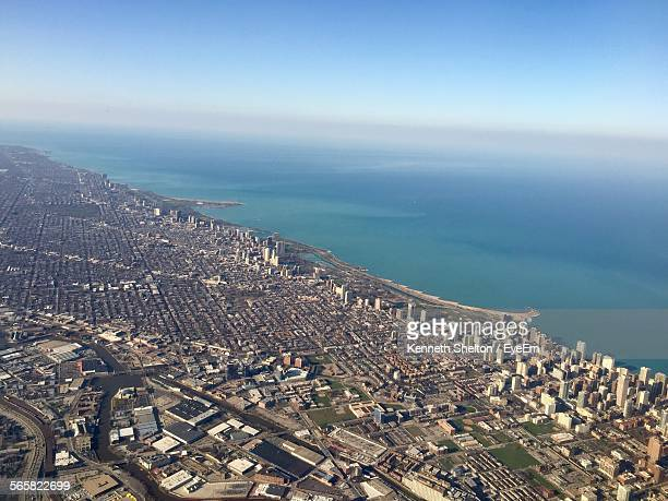 Aerial View Of Cityscape By Sea Against Clear Blue Sky