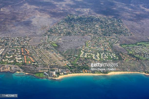 aerial view of cityscape by sea - pacific islands stock pictures, royalty-free photos & images