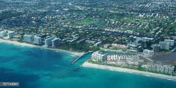 aerial view of cityscape by sea - coral springs stock pictures, royalty-free photos & images