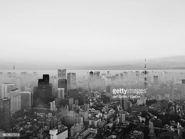 Aerial View Of Cityscape Covered With Fog