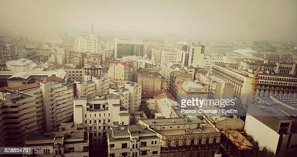 Aerial View Of Cityscape In Foggy Weather