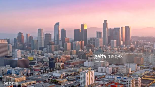 aerial view of cityscape of los angeles shining at sunrise - city of los angeles stock pictures, royalty-free photos & images