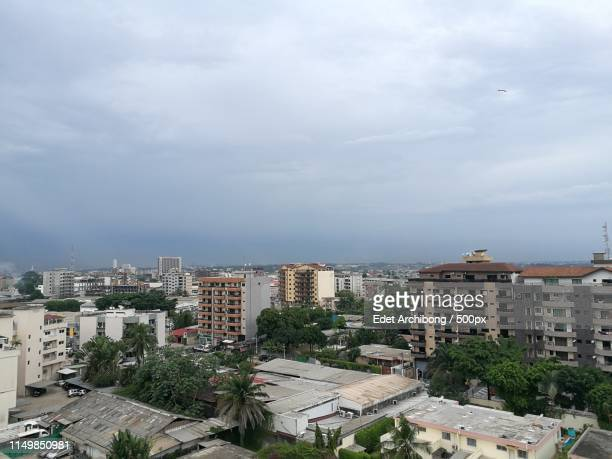 aerial view of cityscape - côte d'ivoire stock-fotos und bilder