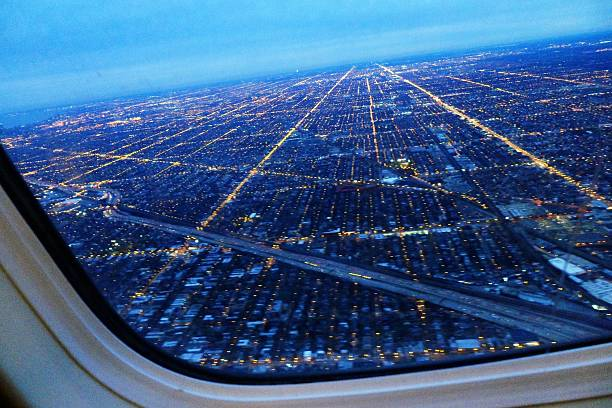 Aerial View Of Cityscape Seen Through Airplane Window Wall Art