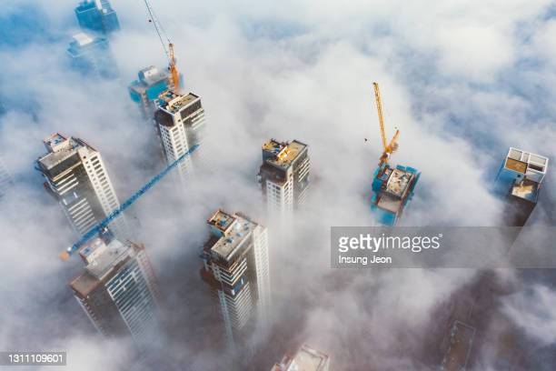 aerial view of cityscape with clouds - south korea stock pictures, royalty-free photos & images