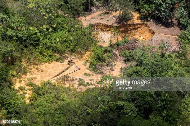Aerial view of clandestine gold mining in Amazonian forest on October 12 in French Guyana / AFP PHOTO / Jody AMIET