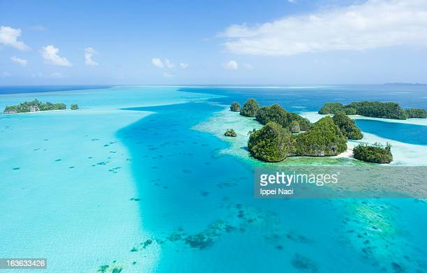 Aerial view of clear blue sea and tropical islands
