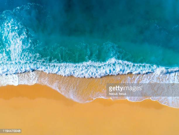 aerial view of clear turquoise sea and waves - water's edge stock pictures, royalty-free photos & images