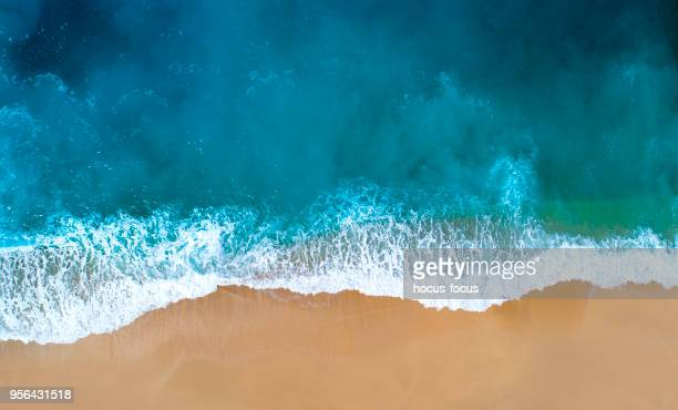 aerial view of clear turquoise sea - coastline stock photos and pictures