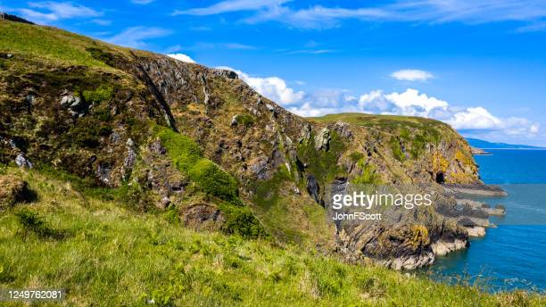 aerial view of cliffs leading down to the sea in dumfries and galloway, south west scotland. the image was captured by a drone on a bright sunny summer afternoon. - johnfscott stock pictures, royalty-free photos & images