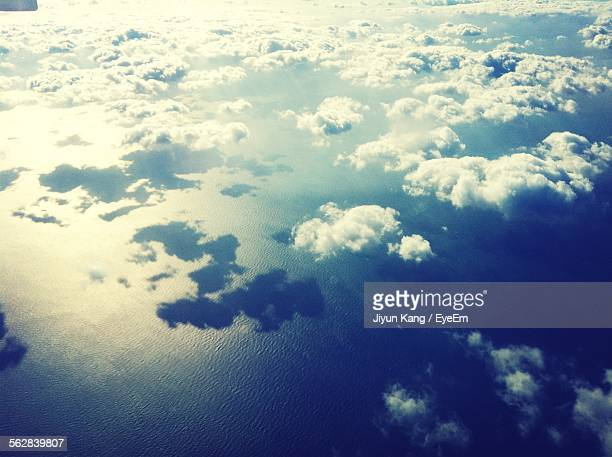 Aerial View Of Clouds Above Sea