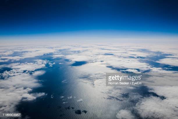 aerial view of clouds over blue sky - planet earth stock pictures, royalty-free photos & images