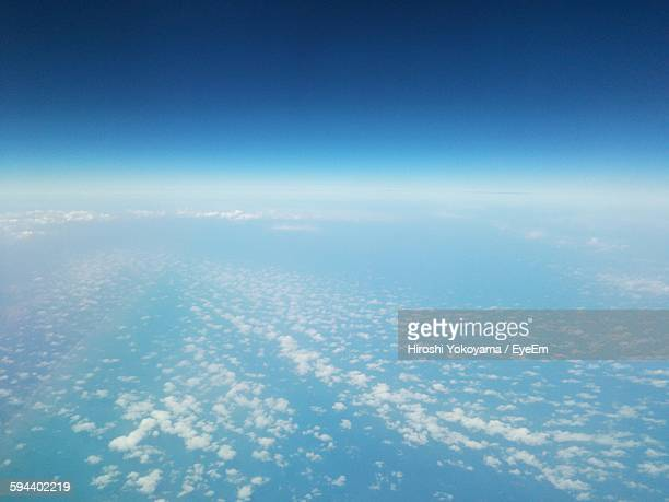 Aerial View Of Clouds Over Sea Against Clear Sky