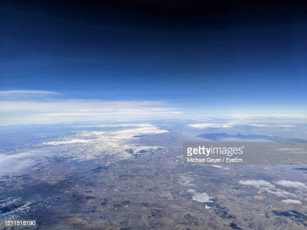 aerial view of cloudscape against sky - atmosphere stock pictures, royalty-free photos & images