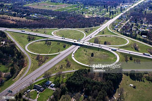 aerial view of cloverleaf freeway intersection in south bend, indiana - indiana stock-fotos und bilder