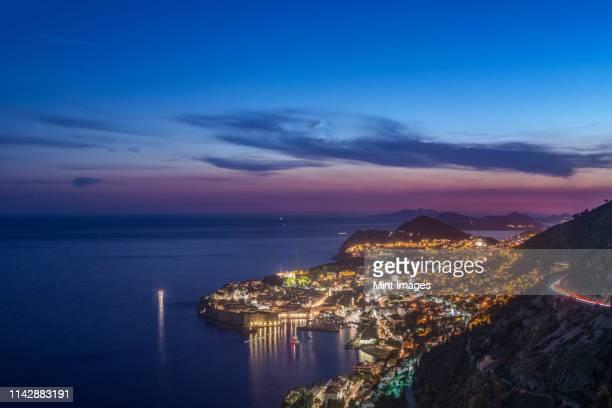 aerial view of coastal city illuminated at night, dubrovnik, dubrovnik-neretva, croatia - アドリア海 ストックフォトと画像