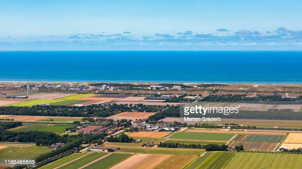 aerial view of coastal town petten with nuclear facility in noord-holland - merten snijders stock pictures, royalty-free photos & images