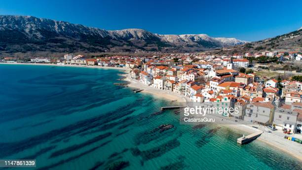 aerial view of coastline town of baska, krk island , croatia - croatia stock pictures, royalty-free photos & images