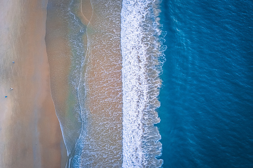Aerial view of coastline with beach and ocean waves, taken by drone - gettyimageskorea
