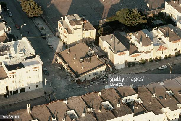 aerial view of collapsed building - loma prieta earthquake stock pictures, royalty-free photos & images