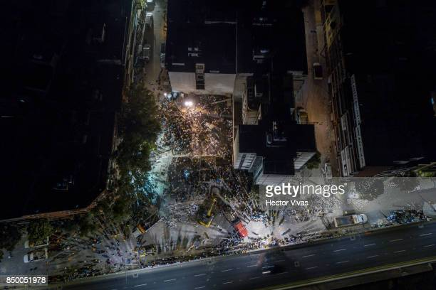 Aerial view of collapsed buildings after the magnitude 71 earthquake that jolted central Mexico damaging buildings knocking out power and causing...