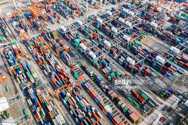 aerial view of colorful container terminal - global trade war stock pictures, royalty-free photos & images