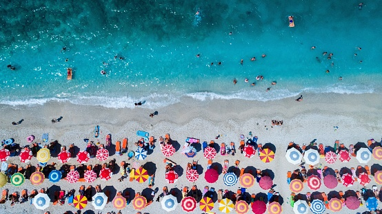 Aerial View Of Colorful Umbrellas On Shore At Beach - gettyimageskorea