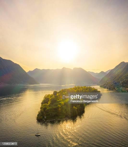 aerial view of comacina island illuminated by sunset light. - italia ストックフォトと画像
