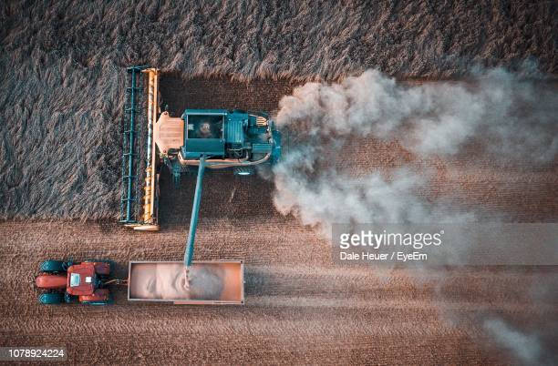 aerial view of combine harvester in farm - combine harvester stock pictures, royalty-free photos & images