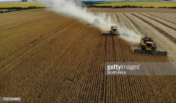 Aerial view of combine harvesters being used to harvest soybeans in a field at Salto do Jacui, in Rio Grande do Sul, Brazil, on April 5, 2021. - Rio...