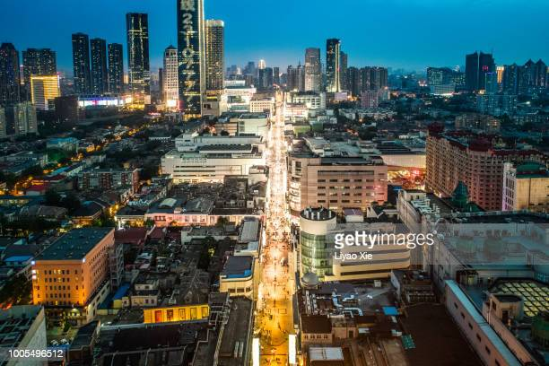 aerial view of commercial district - liyao xie stock pictures, royalty-free photos & images