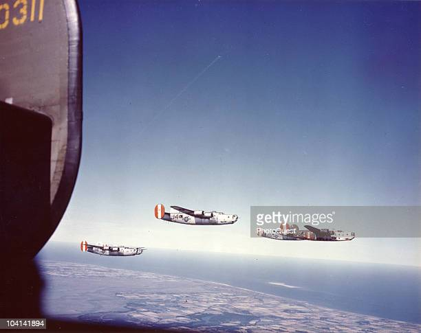 Aerial view of Consolidated B24 Liberator heavy bombers in flight over the North Sea 1940s The lead plane is distinguished by polka dot markings